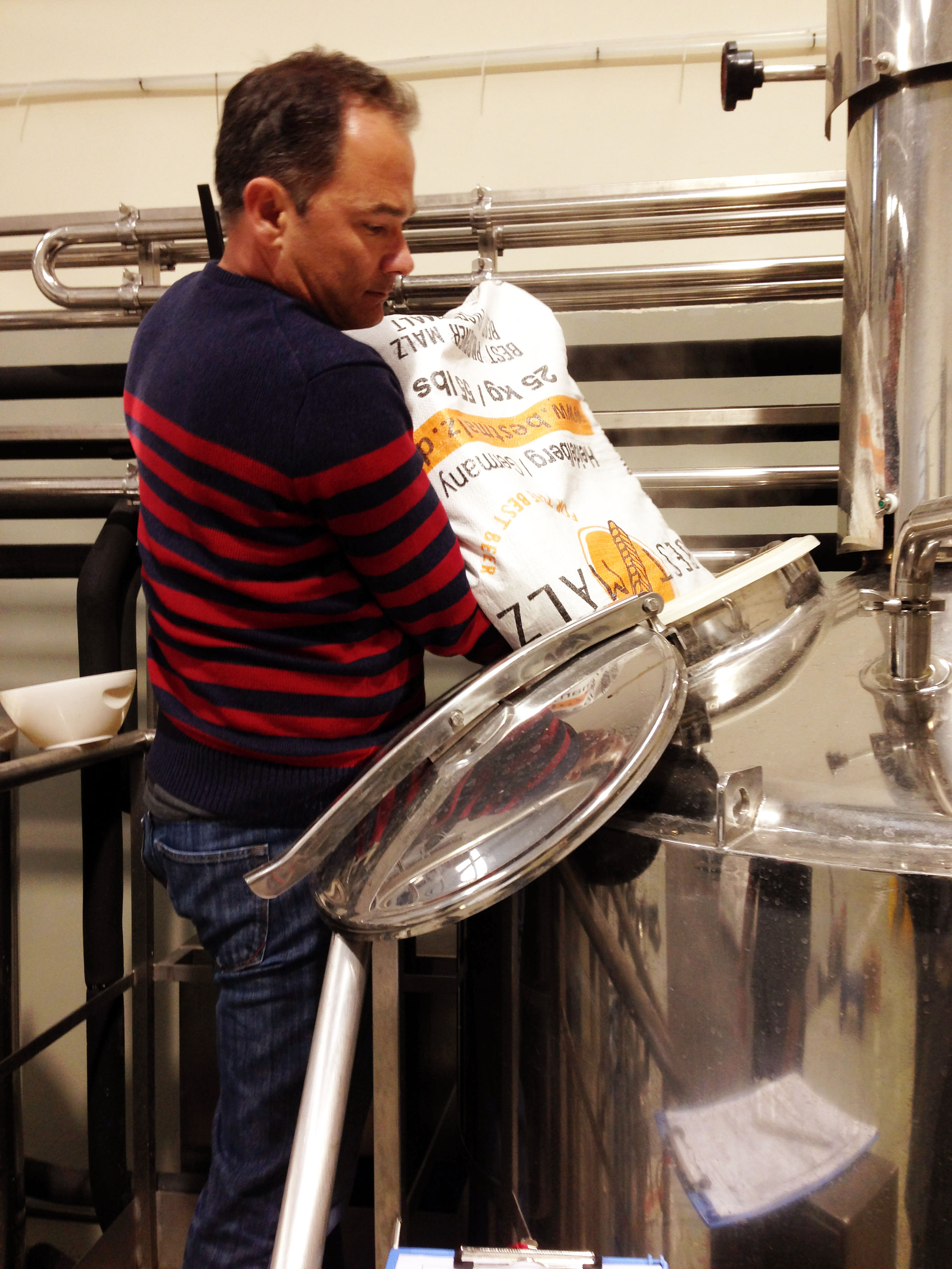 Michael from Sublime Imports helps mashing in.