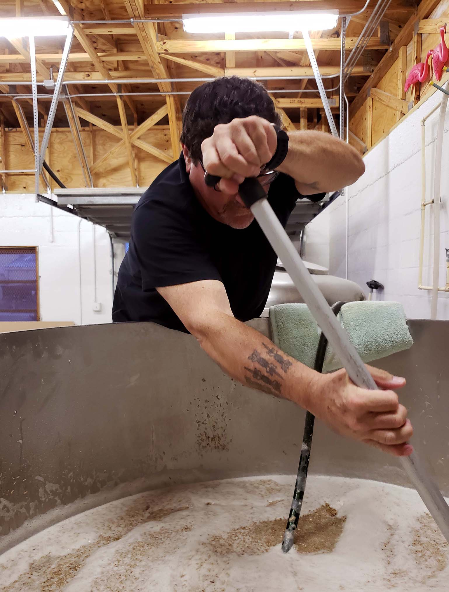 """Stirring the mash """"the way beer was brewed 100 years ago""""."""